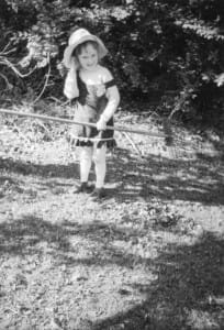 Me in the garden with a rake ... I can't say I garden these days in a dress and stockings!