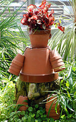 Flower pot man garden art | The Micro Gardener