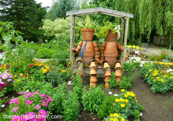 Small Garden Design Idea: Flower pot men made out of terracotta pots and plants for 'hair' add a sense of fun. Get creative!