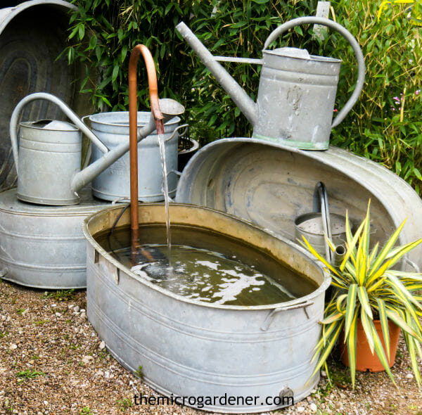 Small Garden Design Idea: A collection of galvanized metal containers and water feature focal point in garden design | The Micro Gardener
