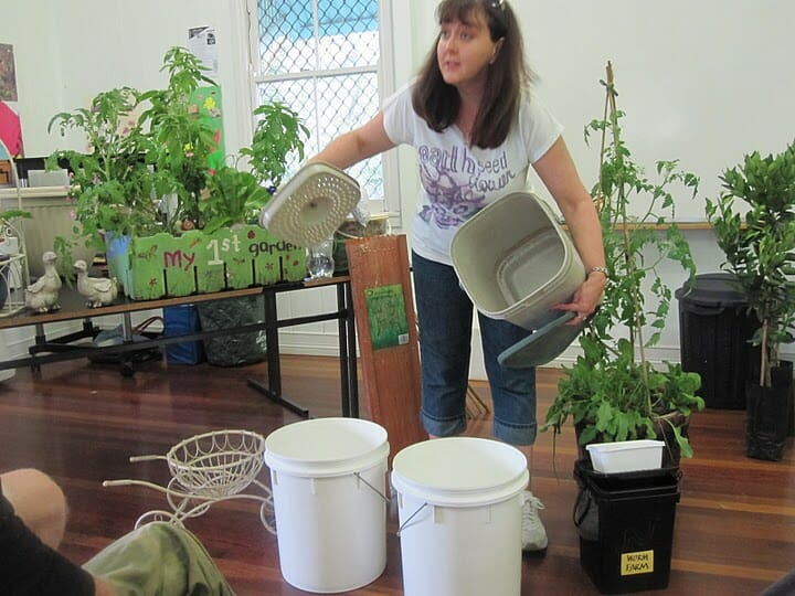Demonstrating how to use a bokashi bin & a variety of mini compost systems