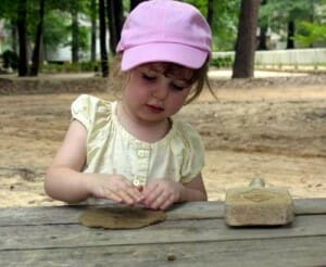 Girl making clay garden art