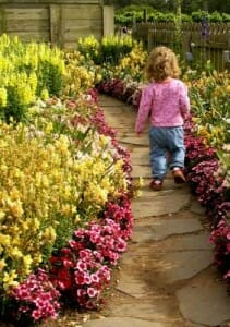 Children love walking through a flower garden