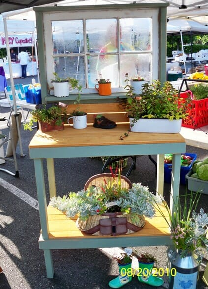 Potting bench with repurposed window - Furniture items often take up a huge amount of space in landfill but when refashioned into useful items are far more environmentally friendly. | The Micro Gardener