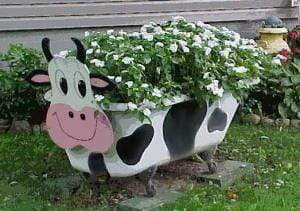 A quick spray paint and a bit of artistic flair has turned this old bathtub into a cow planter!  | The Micro Gardener www.themicrogardener.com