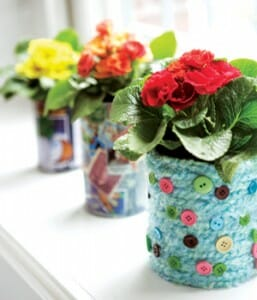 These colourful pots have found new life after being repurposed from tin cans.