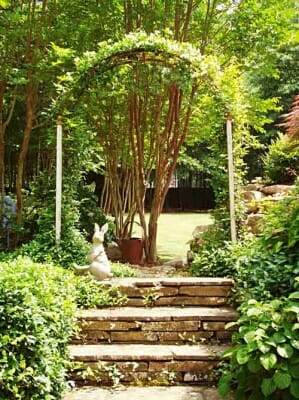 Arbor on path via www.prana.com where Bonnie Helander shares her tips on what makes a great garden.
