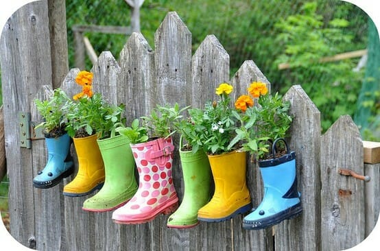 Kids rain boot planters - if you have children, you know how fast they grow out of shoes.