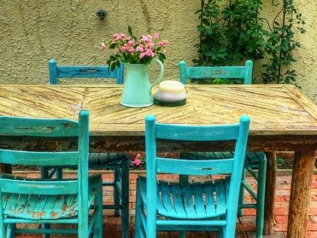 Perhaps your outdoor dining space is more eclectic ... with a restored table and chairs like this one? Photo: Frank DiBona