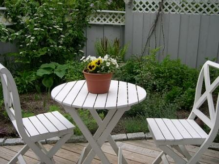 In a micro garden, simple spaces are best ... like this fresh white table for two. Photo: Brian Christiansen