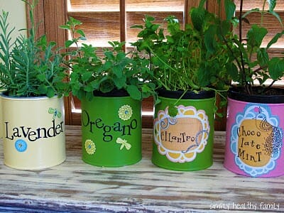 Mini window sill herb garden in upcycled can planters | The Micro Gardener