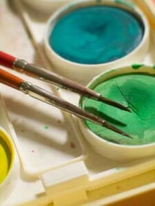 Colourful non-toxic paints can be used to brighten up pots and containers