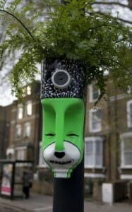 This gardener had a sense of humour when creating this Milk Bottle head garden planter - a great idea for kids gardens. Photo by Recycle for the Arts.