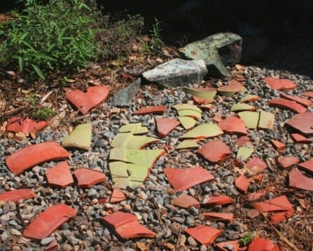 Use pot shards as a decorative feature in the garden | The Micro Gardener